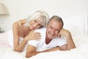 Senior couple fooling around in bed womens sexual satisfaction