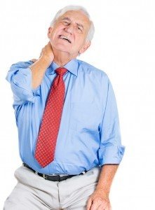 Senior man experiencing muscle pain in his neck area