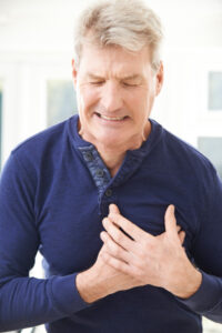 Man having a heart attack chest pain