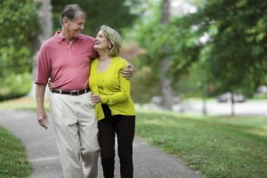 Attractive mature couple walking in  park