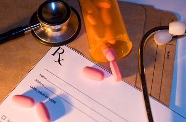 Prescription pad and pills to illustrate seniors taking too many meds