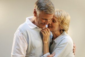Attractive senior couple in an intimate embrace.