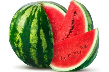 Watermelon and slices an example of summer foods to beat belly fat isolated on white background