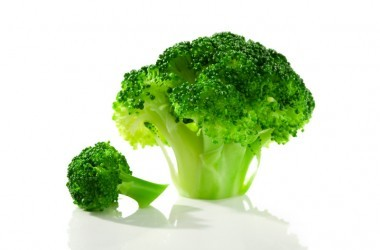 large and small broccoli florets isolated on white background
