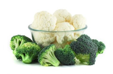 Cauliflower in transparent bowl and broccoli isolated on white cruciferous vegetables