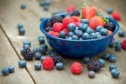 A bowl of delicious organic berries. Strawberries, blackberries, blueberries and raspberries.