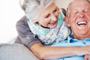 A happy senior couple relaxing together their good attitude fights memory loss