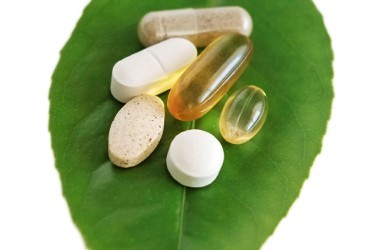 Supplements pills on a leaf portrait shape