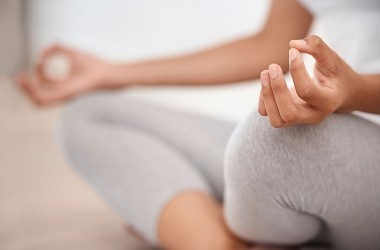 Woman meditating for relaxation, stress relief and to improve attention span
