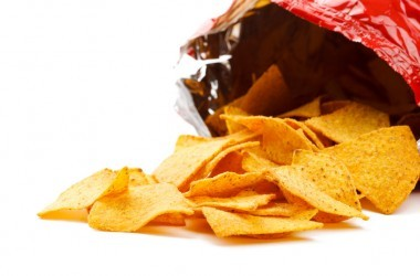 Corn tortilla chips spilling out of a bag