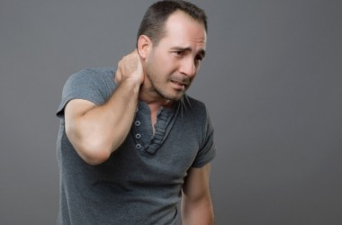 Man holding his neck in pain needs solution to fight pain