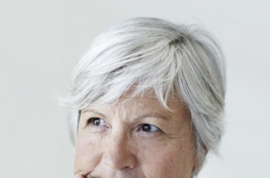Older woman with grey hair with high blood pressure