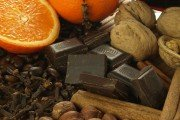 Dark chocolate pieces, sliced oranges, nuts in the shell