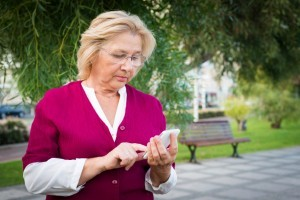 Mature woman on cell phone texting
