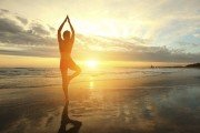 Silhouette of a woman doing yoga in sunshine
