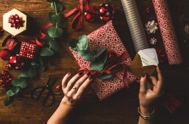 Woman wrapping last minute Christmas gifts