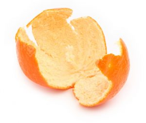 Close-up of citrus peel from an orange on white, natural shadow in front.