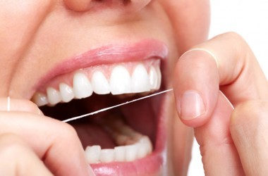 Close up of a woman flossing