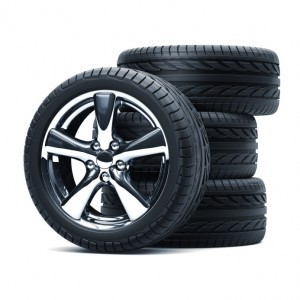 Stack of car tires on a white background.