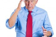 Senior man trying to recall something possibly dementia or memory loss
