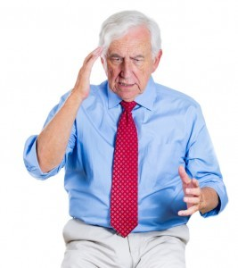 Senior man trying to recall something possibly dementia