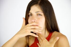 Woman coughing needs a cough suppressant