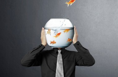 man with fishbowl head follows Alzheimer's proof your brain advice to eat more brain food