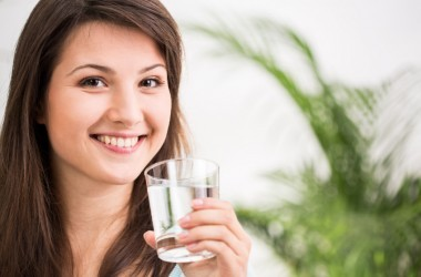 Fit and trim woman drinking water
