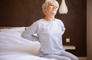 Senior woman looking for low back pain relief