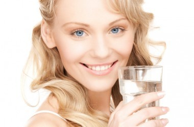 Smiling woman with water glass