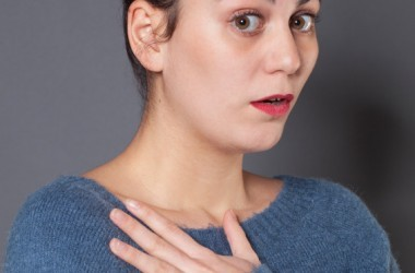 Stressed depressed woman holding her heart