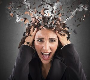 Stressed woman with exploding smoking head