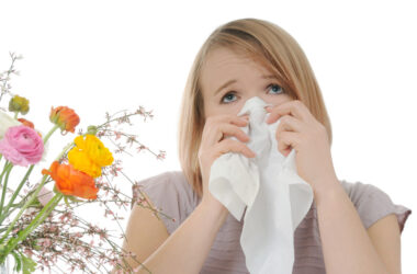 Woman suffering from spring allergies