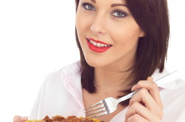 woman eating curry with turmeric to control blood sugar