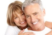 Smiling senior couple with healthy white teeth
