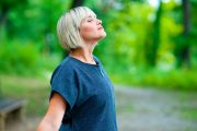 Middle aged woman with asthma takes deep breath