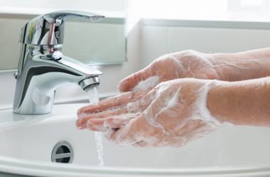 Washing hands with antbacterial soap triclosan