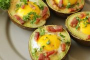 Egg stuffed avocado with bacon crumbles