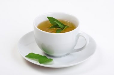 Tea cup with mint tea and mint leaves