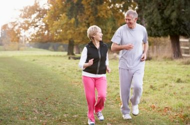 Senior couple walking for exercise at faster walking pace