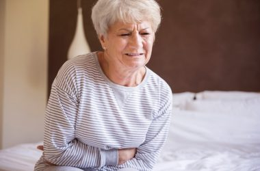 Woman holding upset stomach nervous stomach needs to try stomachache home remedies
