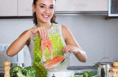 Woman prepares salmon to avoid Alzheimer's and prevent Alzheimer's