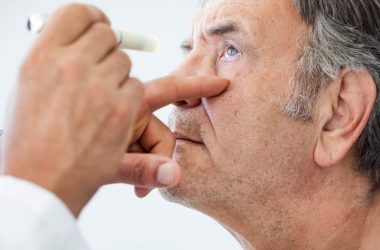Diabetic man being examined by an ophthalmologist for cataracts