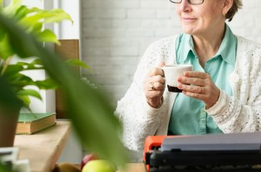 Senior woman using memory trick of looking at green plants and nature