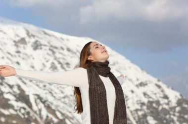 Woman with healthy lung function taking a deep breath