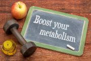 Boost your metabolism written on blackboard to combat metabolism slowing