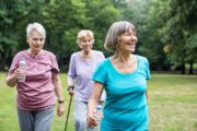 Healthy senior women doing spring exercise in park