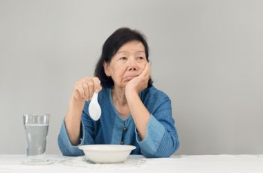 Senior woman with poor appetite isn't interested in food