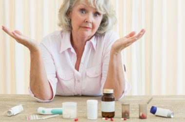 senior woman with a variety of pills which could kill good bacteria