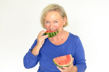 Woman bites into a slice of metabolism boosting watermelon